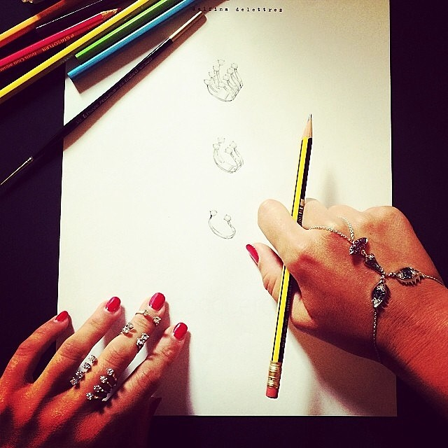 #Regram courtesy of #delfinadelettrez. She is clearly hard at work sketching and wearing her own #dot #rings