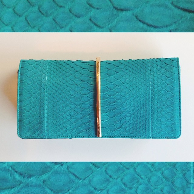 Up close and personal with our @NinaRicci turquoise python clutch with gold hardware. A spring must-have!