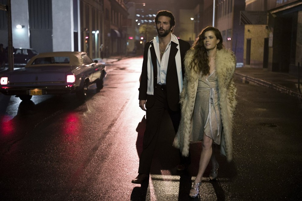 "womensweardaily: Bradley Cooper and Amy Adams in ""American Hustle."" Photo by Francois Duhamel/Annapurna Productions LLC/Columbia Pictures"