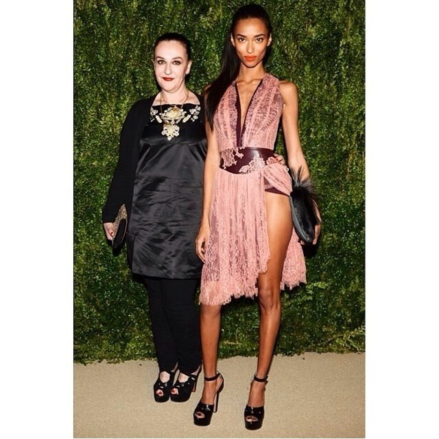 #regram - former CFDA winner @sophietheallet attended this year's ceremony accompanied by model @realanaismali . Anais wore a pink lace dress from Sophie's SS14 collection, which will be available at Serenella.