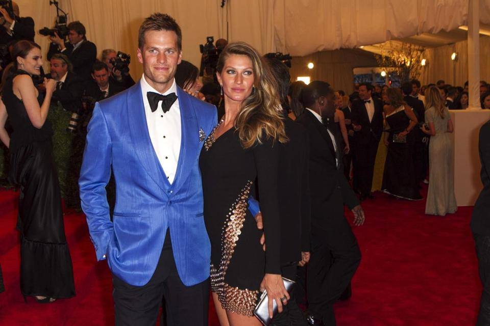 """Now if only all men could be as dapper as Tom Brady! """"Roll your eyes and blame his wife if you like, but Brady looked quite comfortable at the Met Gala this month in a blue moire jacket and waistcoast by Tom Ford.""""The Boston Globe"""