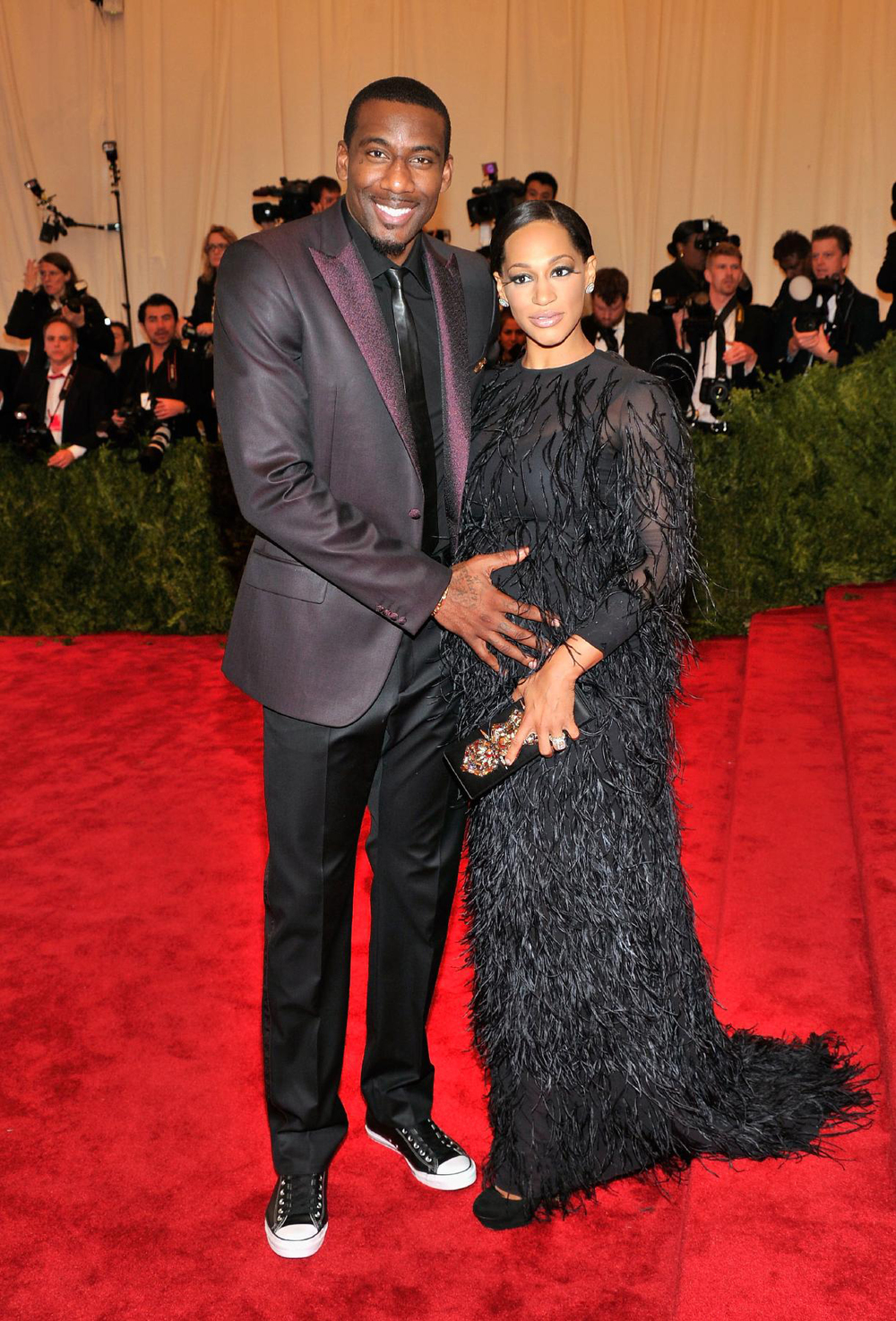 2013 Met Gala: Mother-to-be Alexis Welch was glowing in a black feathered Giambattista Valli gown, accompanied by her husband Amar'e Stoudemire.