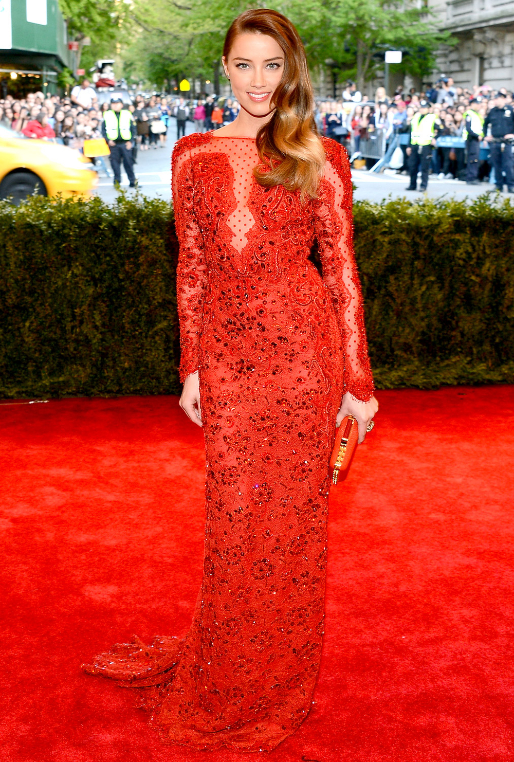 2013 Met Gala:Amber Heardtook to the red carpet in a bright red laceEmilio Puccigown. The actress was the guest of Peter Dundas who custom designed the dress especially for her.