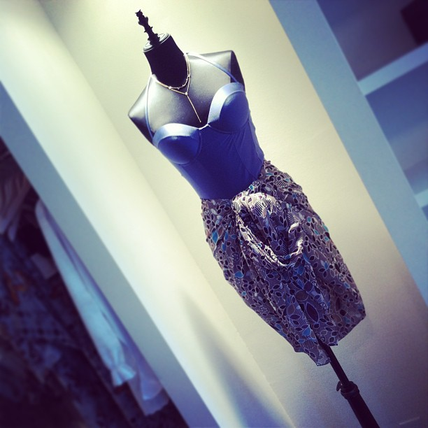 Sinesia Karol one-piece bathing suit and printed orchid wrap and Natasha Collis necklaces (at Serenella Boston)