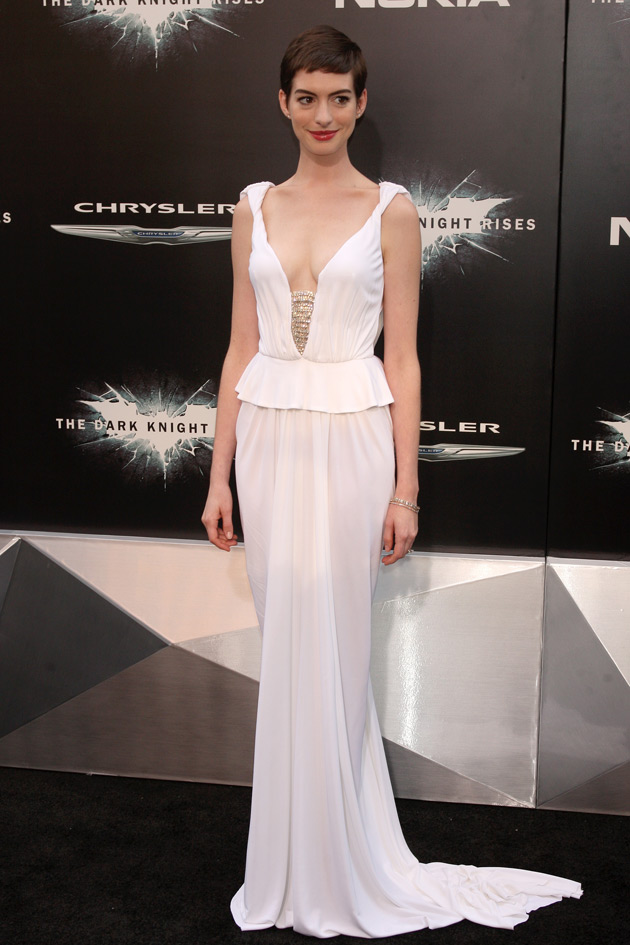 """Anne Hathaway shines inPrabal Gurungat the Dark Knight Rises premiere. """"I loved seeing Anne in this gown. She made it come alive,""""said the designer. Hathaway opted for a long white gown from the Resort 2013 collection at the New York City premiere."""