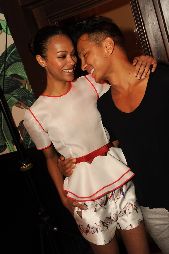 Zoe Saldana celebrated Prabal Gurung in Prabal Gurung on Thursday night at the designer's celebratory party in New York City. Prabal Gurung's number one fan was dressed in an entire outfit from the Resort 2013 collection at the launch party of the designer's newest collection. In a white peplum top with red trim and silk floral shorts, the actress epitomized casual summer style as she embraced the designer on Thursday night.