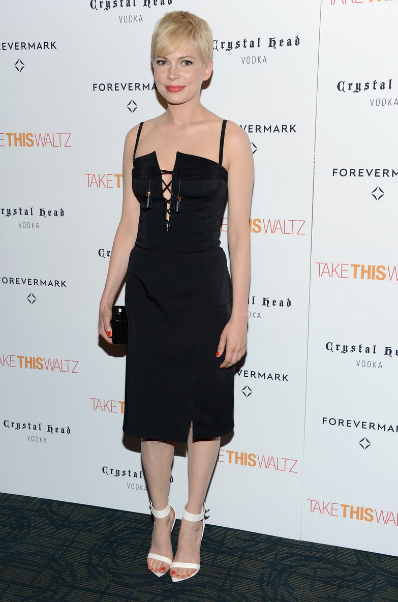 """Michelle Williams wore an Altuzarra dress to her latest movie premiere """"Take This Waltz"""" on Thursday night. The lace-up corseted dress from the Resort 2013 collection is a sexier take on the classic little black dress. The actress paired the black dress with white Givenchy sandals, opting for an understated two-tone look. This modern Altuzarra LBD will exclusively be in Serenella stores soon!"""