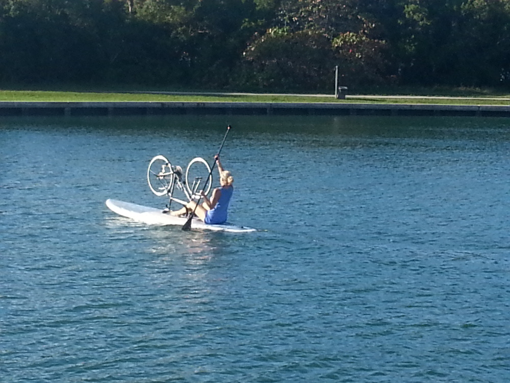 Paddle boarding the bike at No Name Harbor