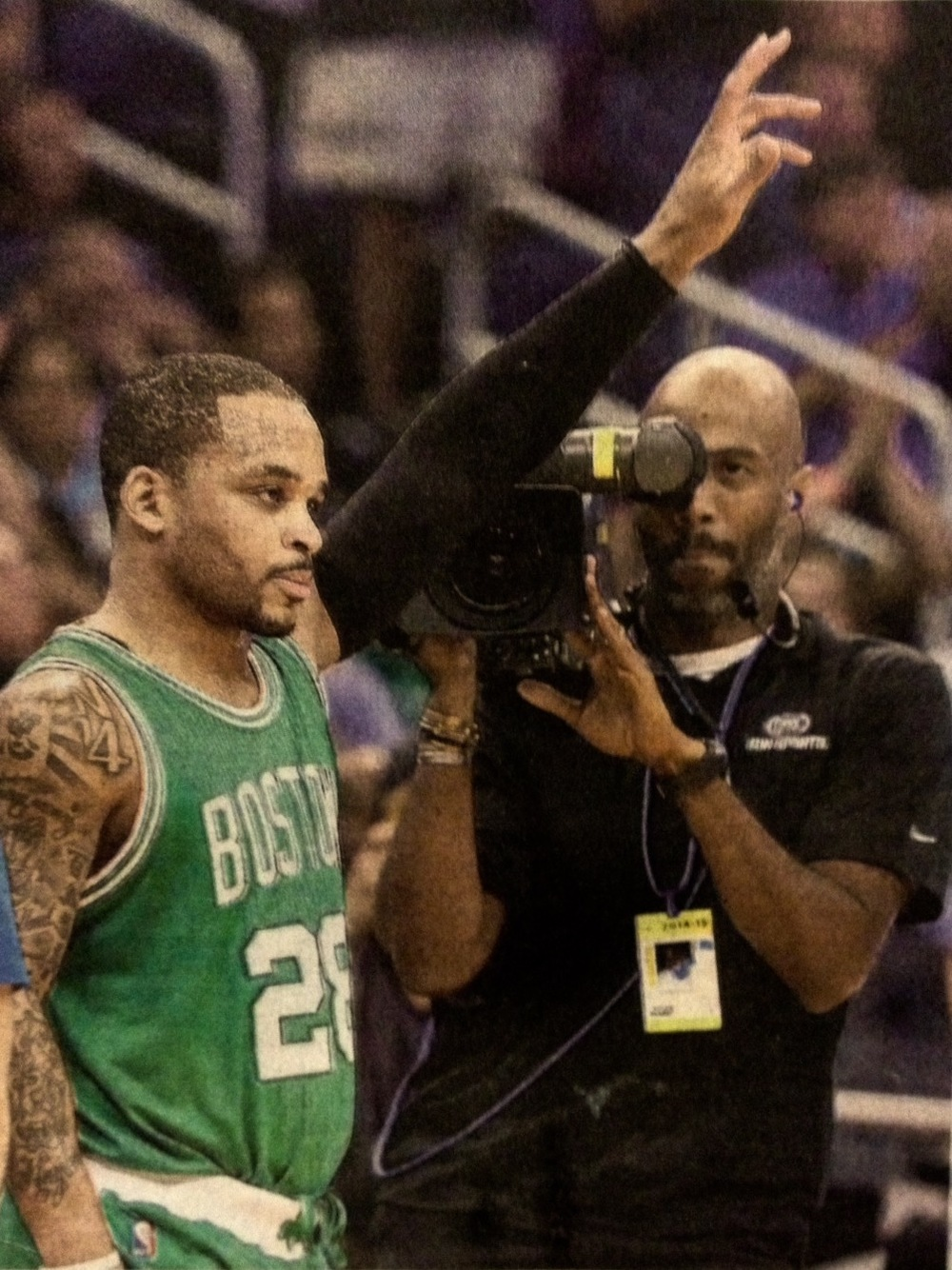 Clem Harrod, Sports Videographer (right) filming Jameer Nelson, Boston Celtics Point Guard (left)