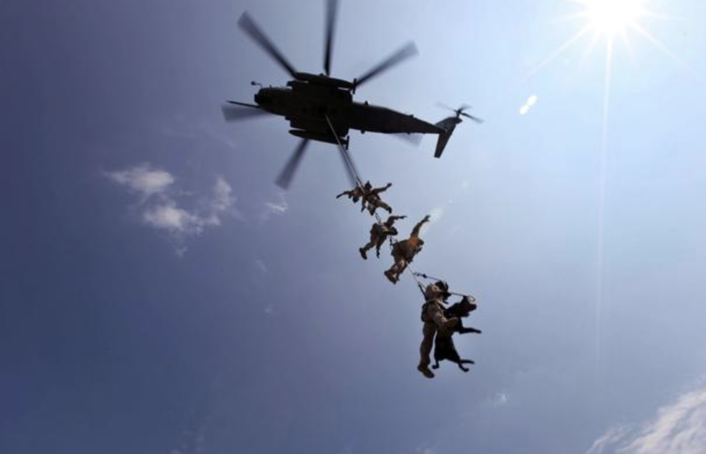 Marines with Marine Corps Special Operations Command conduct a Special Patrol Insertion/Extraction exercise on a CH-53E aboard Marine Corps Base Camp Lejeune, North Carolina in 2013. This training has helped the MARSOC MPC program in developing what will become the standard operating procedures. (Anthony Carter/U.S. Marine Corps)