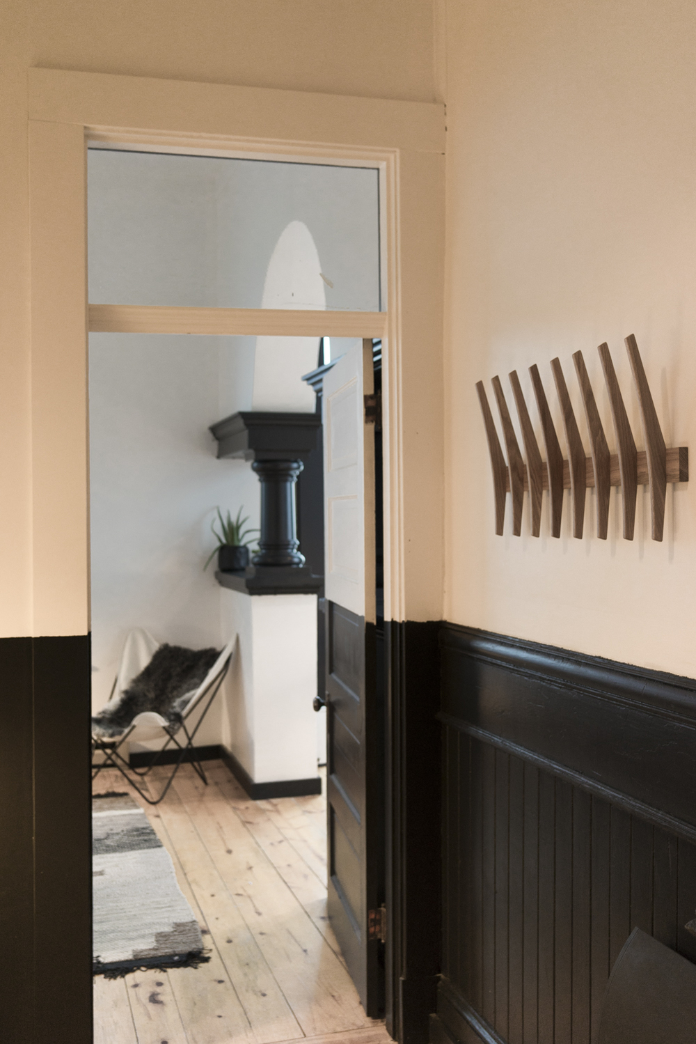 Your view in the front door of room two with 8 fin coat rack by Brendon Farrell