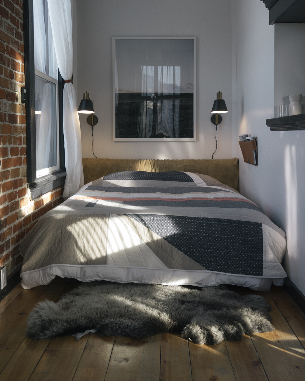 The incredibly comfortable bed with custom headboard from  Revive Designs  and leather magazine pouches from  Wood & Faulk