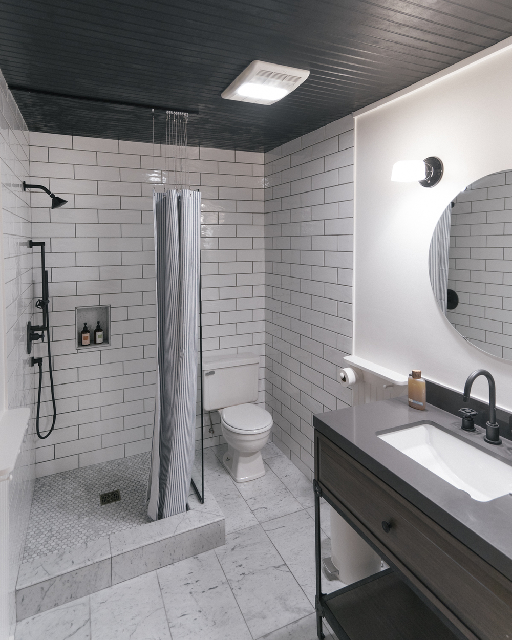 The luxurious bathroom shared exclusively by rooms 3a & 3b, featuring beautiful marble floors and stocked with Juniper Ridge trail soap