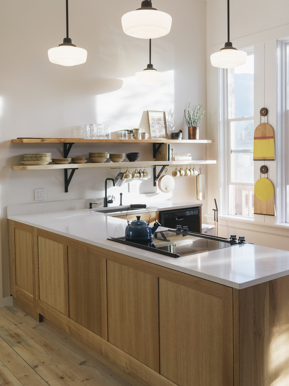 Our communal kitchen, a place to gather, imbibe, be inspired and make friends with cutting boards from  M.Crow  in Lostine