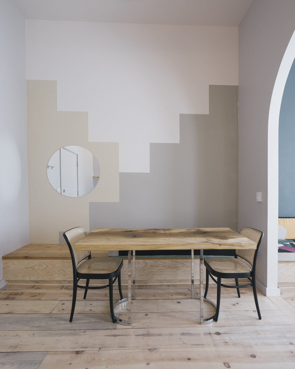 The geometric wall mural and custom table designed by Shelter Collective