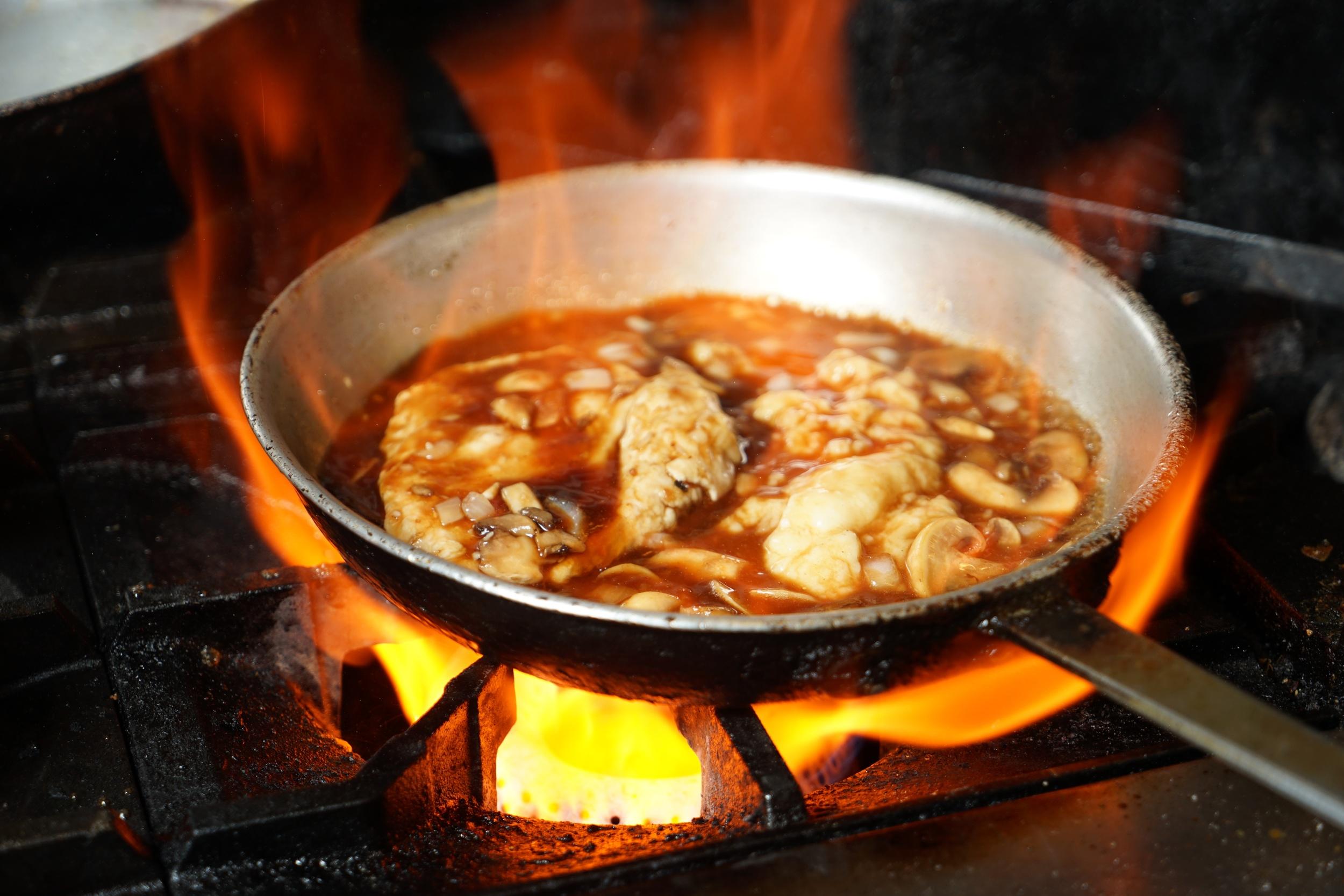 Chef preparing Chicken Marsala
