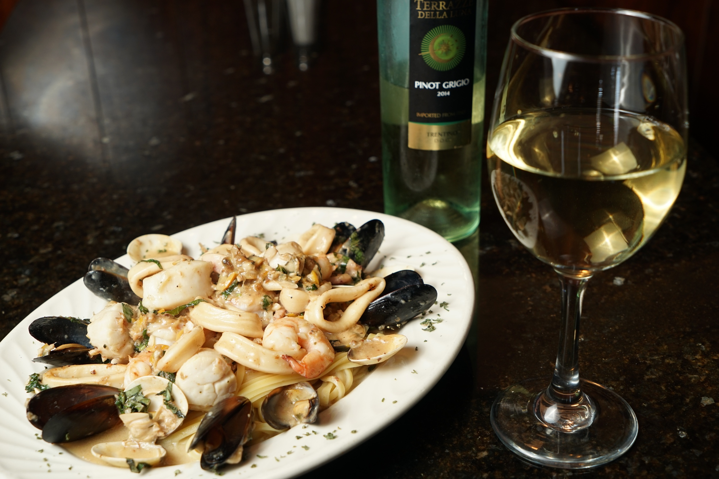 Our classic  Zuppa de Pesce  paired with a unique White Wine