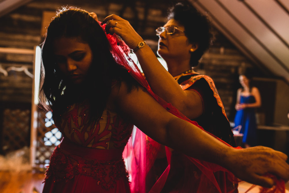 Destination Wedding Photographer Omaha Mother Helping Bride put on veil