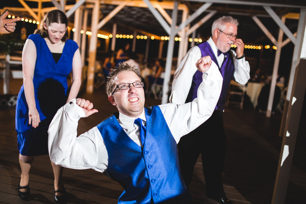 Omaha Wedding Reception Photographer Grooms Brother Party