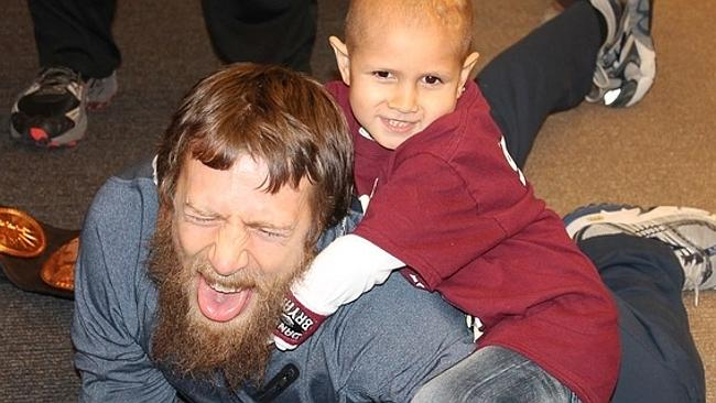 Eight-year-old Connor Michalek meets WWE Superstar Daniel Bryan at a WWE Live Event in Pittsburgh, Pa. in early 2014.