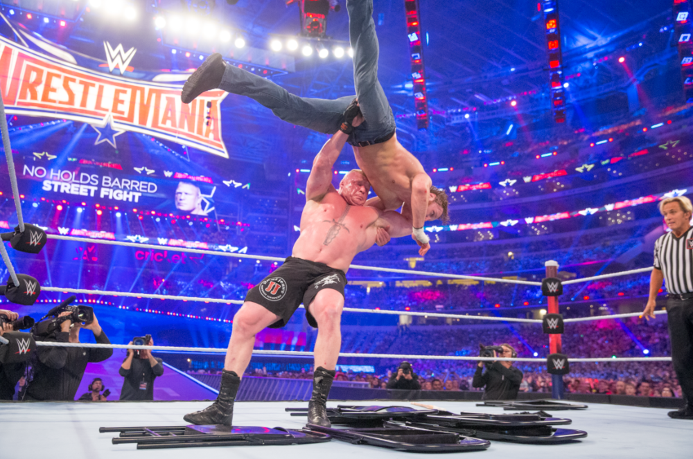 Brock Lesnar slams Dean Ambrose in front of a WWE-record crowd of more than 101,000 at WWE WrestleMania 32 at AT&T Stadium in Dallas, Texas. The April 2016 extravaganza was WWE's most-viewed, most-social event in company history.