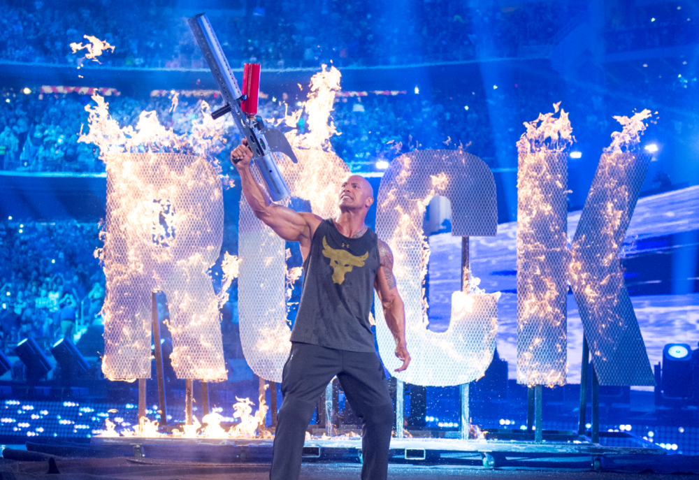 The Rock makes a fiery entrance in front of more than 101,000 at WrestleMania 32 at AT&T Stadium in Arlington, Texas.