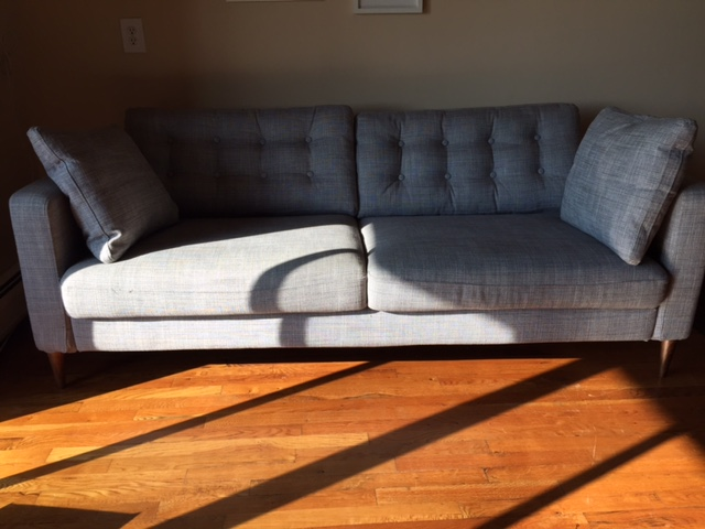 Final result of the Ikea Karlstad sofa after tufting the back cushions and replacing the legs.