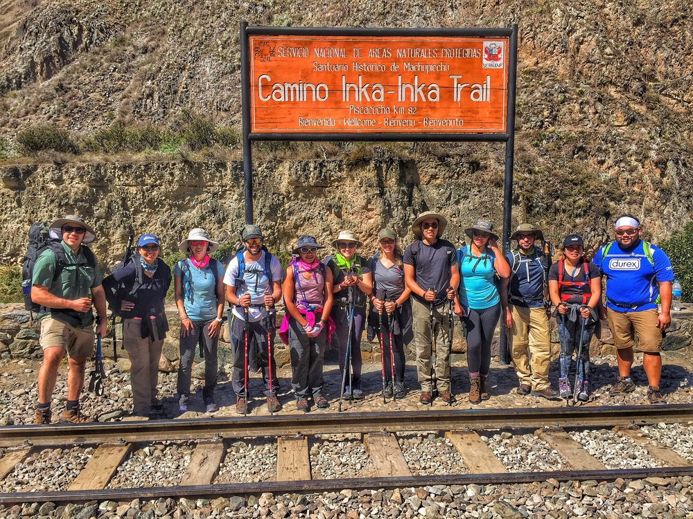 Start of the Inca Trail.  The group looking happy and excited.  Notice the train tracks.  Later, we would wonder why we didn't take the train instead.