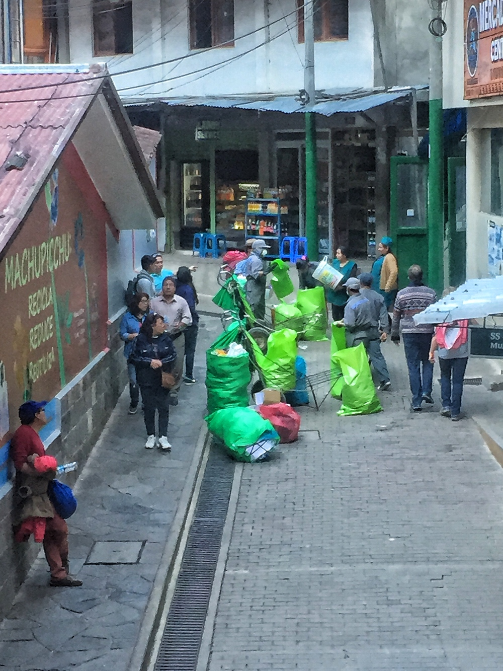 Trash being separated in Aguas Calientes.  Note that the workers have thick rubber globes, masks and full gear on as they separate the trash.