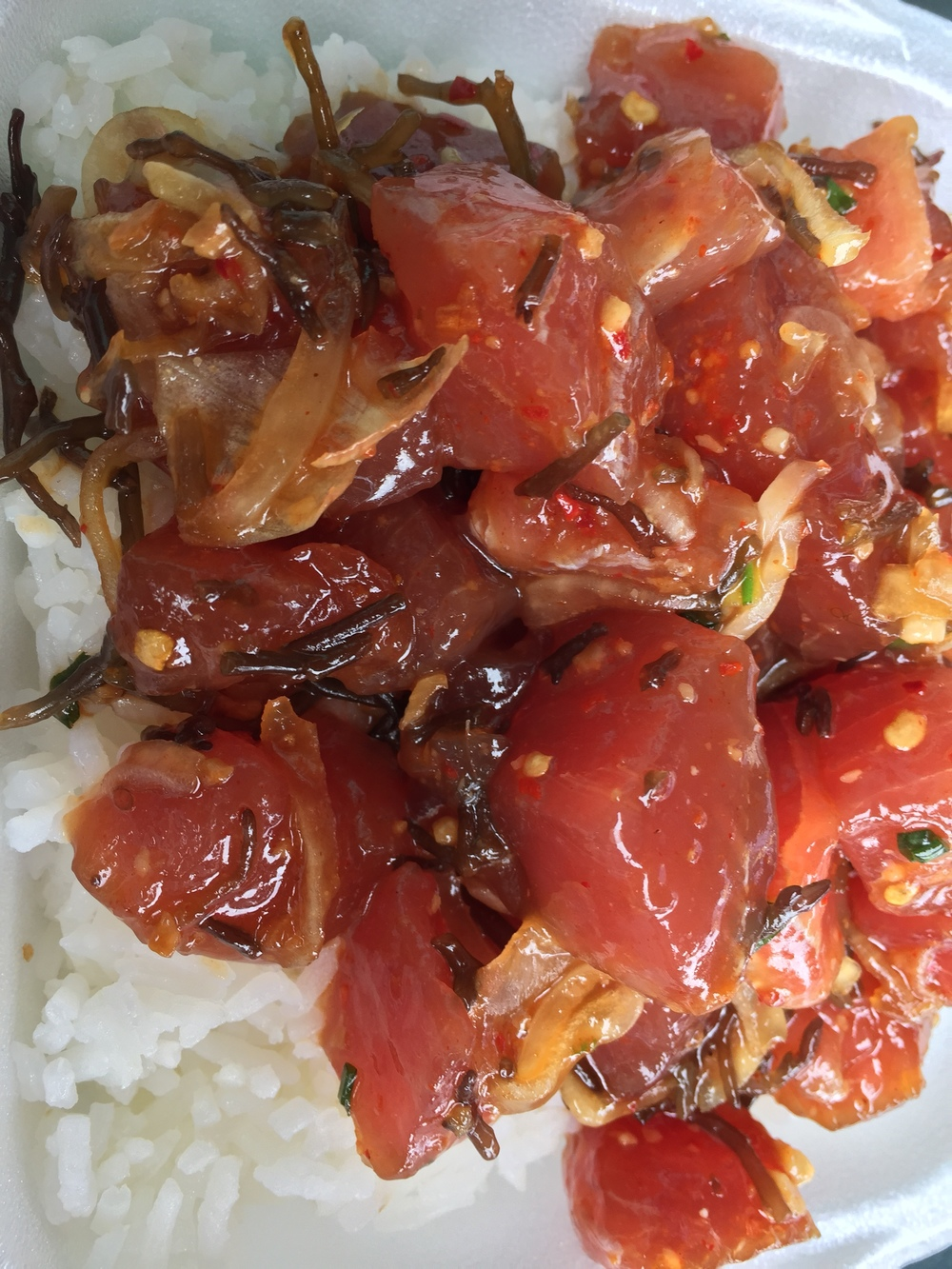 This salad is marinated in soy sauce with seaweed and sits on a bed of rice.  Another way to prepare poke.