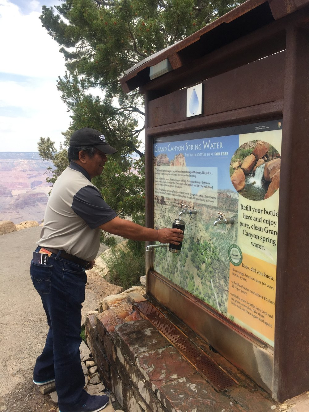 My dad refilling his up at Yavapai Point with Grand Canyon spring water.