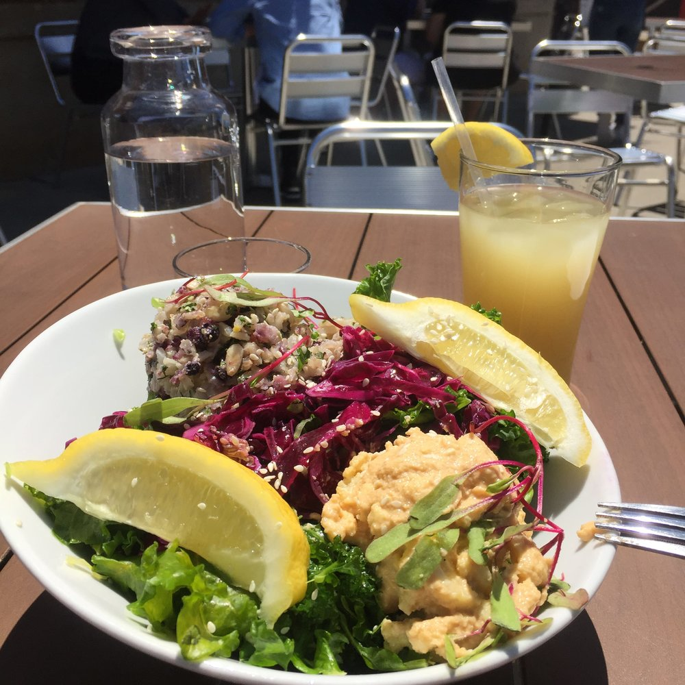 Plant based meals at Charlotte Living Kitchen with fresh lemonade/ginger ale with compostable straw.