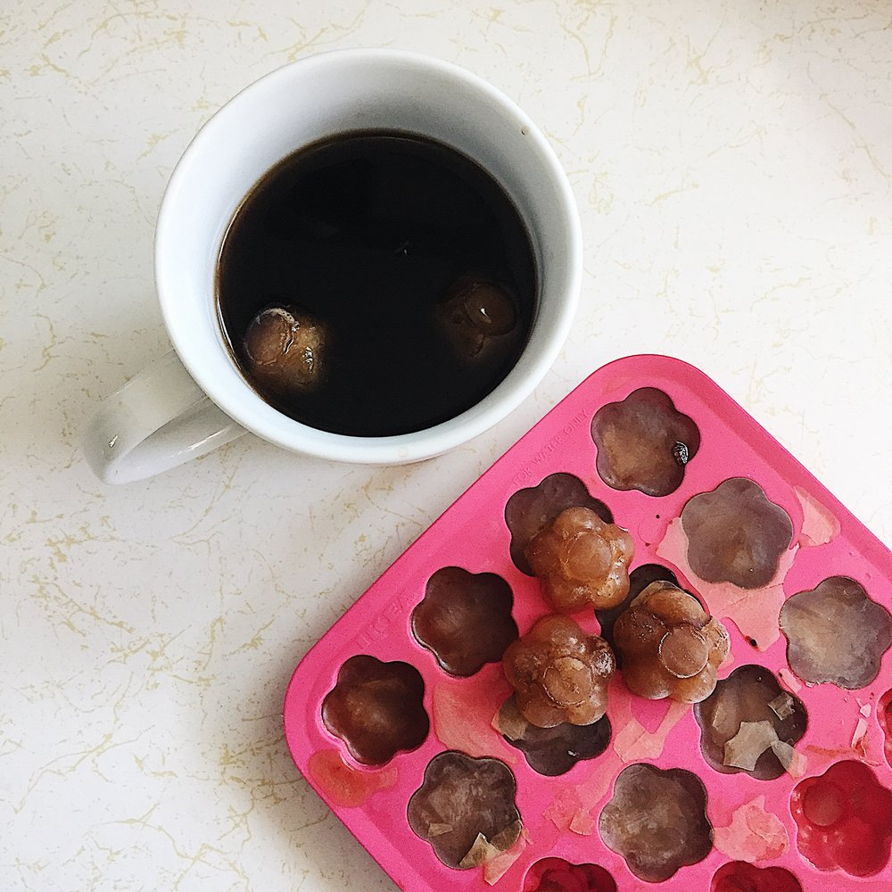 Freezing leftover coffee into ice cubes for later.