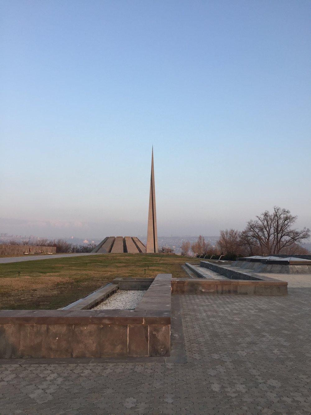On the lef are twelve slabs are positioned in a circle, representing the twelve lost provinces in present-day Turkey. In the center of the circle, at a depth of 1.5 meters, there is an eternal flame dedicated to the 1.5 million people killed during the Armenian Genocide. This memorial is constructed in such a way that anyone who enters must bow their heads in deference to those lost.  One the right is 44-meter stele symbolizing the national rebirth of Armenians.