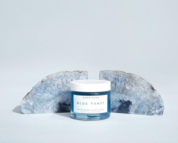 Blue Tansy AHA + BHA Resurfacing Clarity Mask is a truly natural clarifying and cooling gel mask that gently exfoliates, smooths, and resurfaces skin.  Photo credit : Herbivore