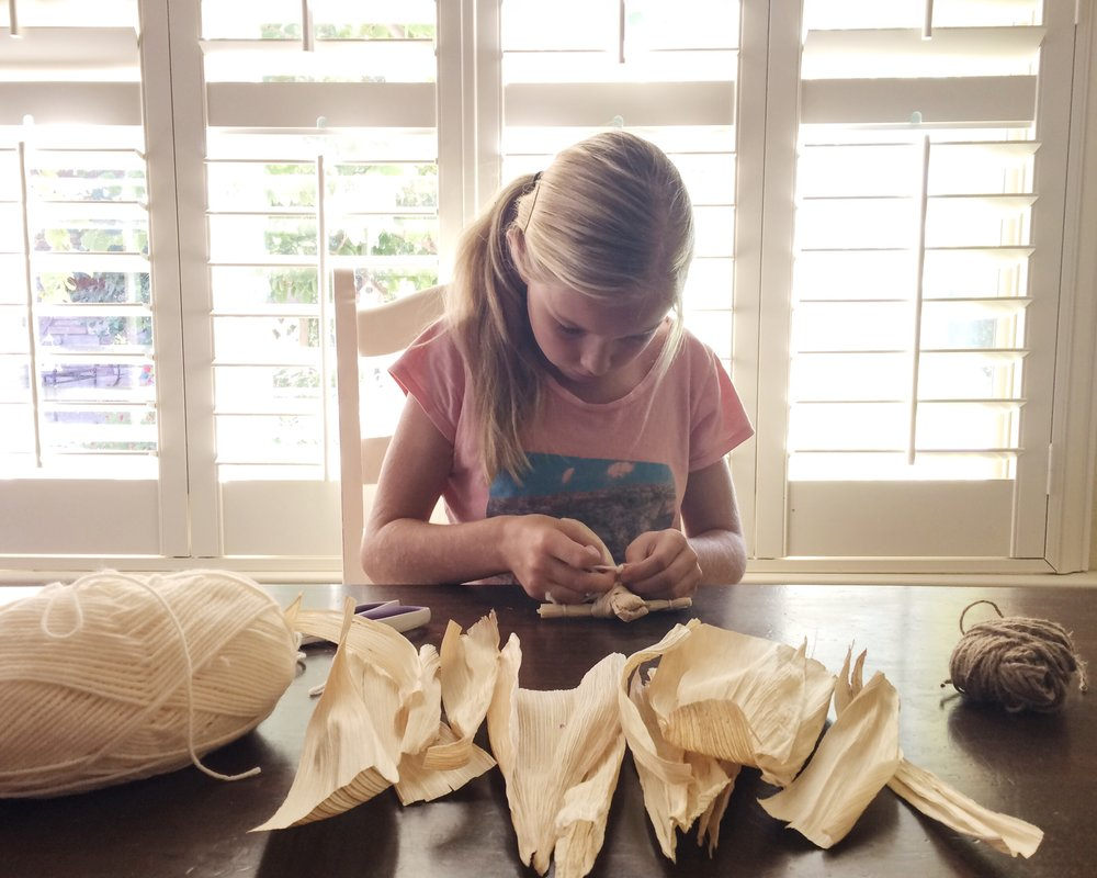 "Making corn husk dolls after reading ""Indian Captive."""