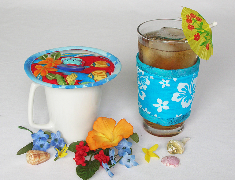 Thinsulate insulated Tropical Dolphins Kup Kap on mug and Hawaiian Teal Kup Kollar on a 16 ounce iced tea glass.