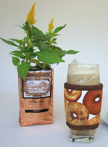 Bagels Kup Kollar on a 16 ounce glass of iced coffee mocha.