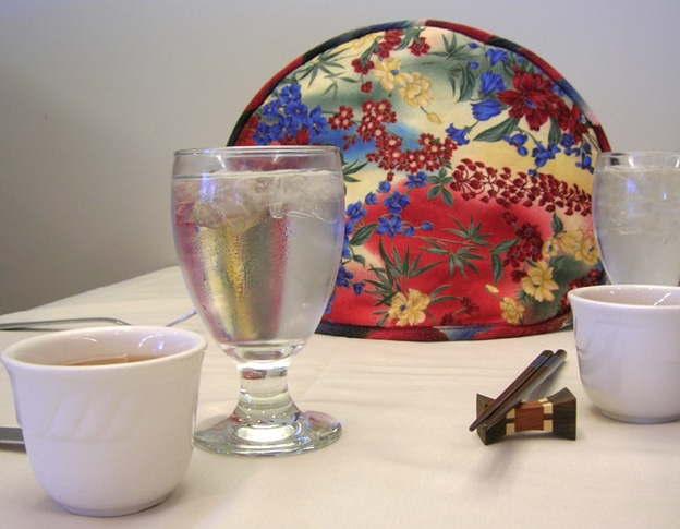 Asian Floral Tea Tabard on teapot.