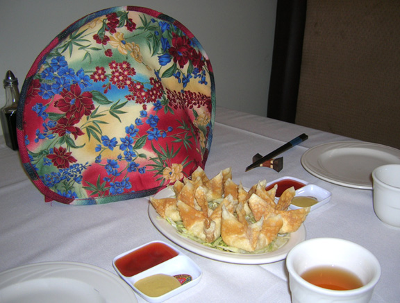 Thinsulate insulated Asian Floral Tea Tabard on a teapot.