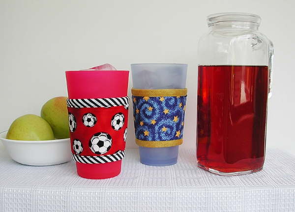 Thinsulate insulated Soccer Balls on Red & Golden Stars Kup Kollars on 16-ounce drinking glasses.