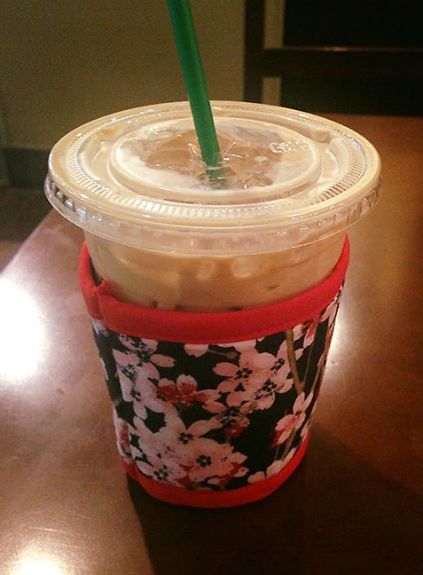 Thinsulate insulated Cherry Blossoms Kup Kollar on 16 ounce cold take-out cup.