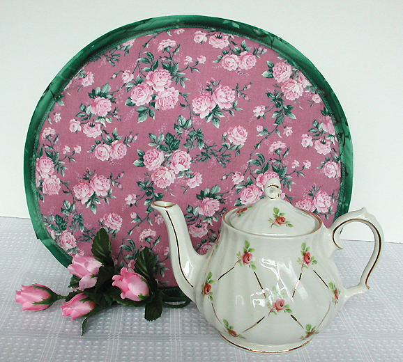 Thinsulate insulated Pink Roses Tea Tabard behind teapot.