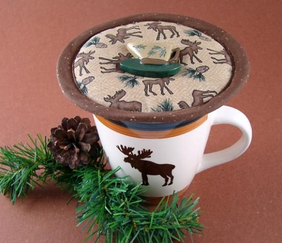 Thinsulate insulated Mighty Moose Kup Kap on mug.