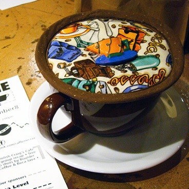Kap KK2_Espresso Medley on cup and saucer with ticket.jpg