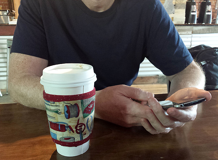 Koffee Kompanions'  Kup Kollar ™  coffee sleeve in more than 30 patterns keeps your coffee hot while playing the latest coffee-themed app on your iPhone or Android phone.