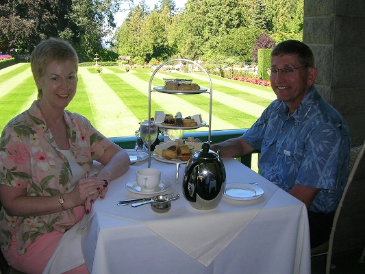 Irene and Perry Luckett, Proprietors of coffee- and tea-accessory company  Koffee Kompanions , enjoying high tea at Butchart Gardens in Victoria, Canada.