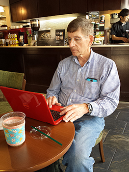 Perry works at Tully's in Tokushima, Japan--using a friend's  Kup Kollar coffee sleeve  by Koffee Kompanions to keep his iced tea cold and his hands dry and comfortable