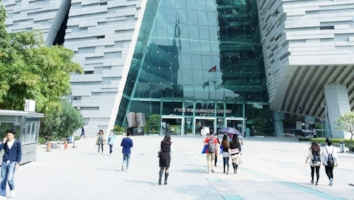 Chinese millennials, such as those pictured here in front of the Guangzhou Library, are driving the coffee-chain explosion in China.