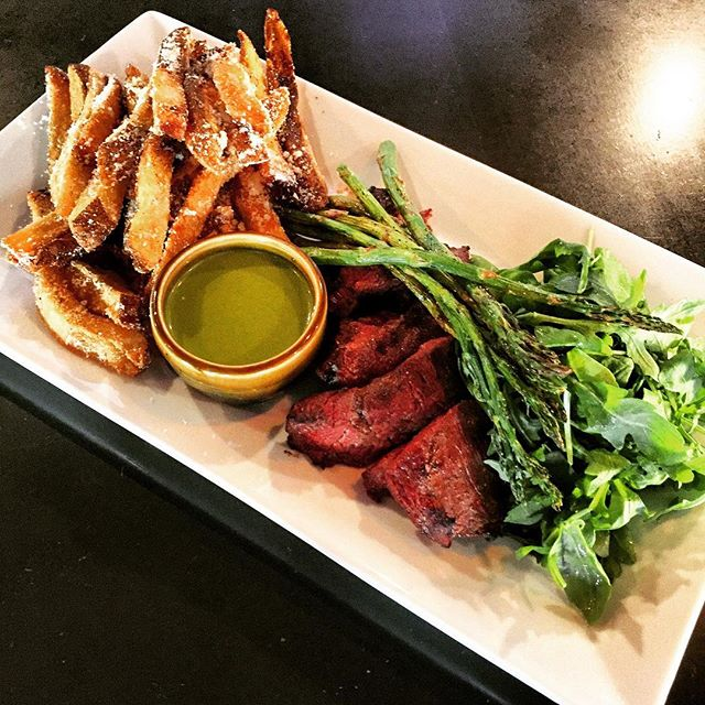 Steak and Fries: grilled hanger steak, Parmesan garlic fries, asparagus, arugula salad, and salsa verde. One of the plates on our new menu we launched yesterday!